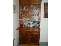 Glass fronted yew cocktail cabinet with two drawers and double cupboard.
