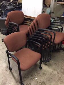 Brown stacking arm chairs on wheels (11 avail)