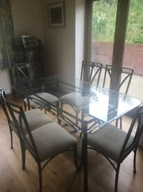 Lovely glass dining table and 6 chairs