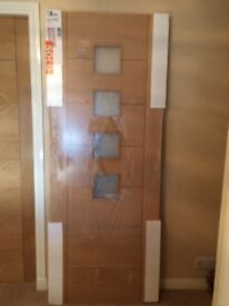 Brand New Palerno oak interior door with obscure glazing