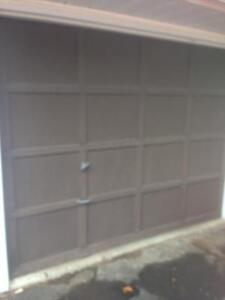 used wood garage door with new track