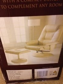 Reclining chair, faux cream leather. New and still in box.