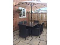 Brown rattan outdoor dining set