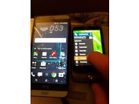 Two HTC 530 and old HTC Android smartphones