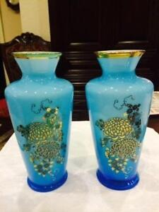 a pair of turquise glass vases