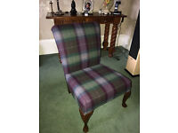 Newly upholstered chair covered in high quality tartan fabric