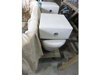 White dual flush toilets x2