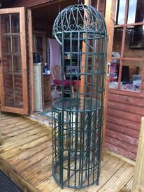Bird cage style bar made from metal painted bottle green