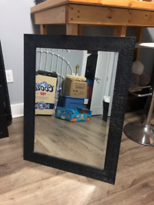 Large black plastic framed mirror. Like new.