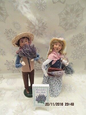 BYERS CHOICE 2002 LAVENDER LADY AND MAN WITH SIGN