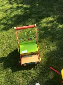 Wooden stroller with play bricks £3