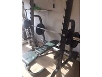 Olympic rack with incline bench used.