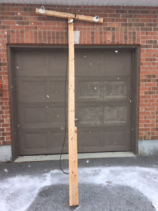 Pole with flood lights & snow fence. Used for back yard rink