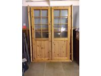 Pair of pine internal, part glazed doors in very good condition.