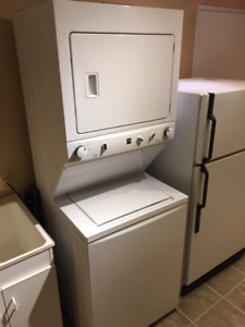 Kenmore washer dryer combo, laundry center, stackable. 2 years o