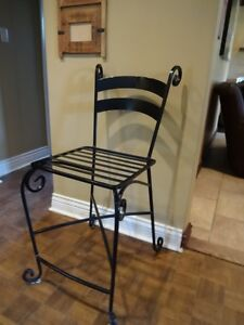 Four Wrought Iron Chairs Come see us at 36 Lamont in Dollard-des