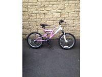 Girls Suspension Bike in Pink.
