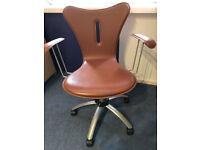 Brown swivel desk chair