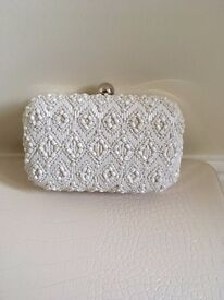 White bead embellished clutch bag