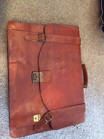 Brown vintage lawyer bag with buckle fastening