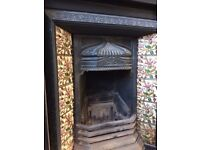 Beautiful ornate cast iron fireplace with tiling