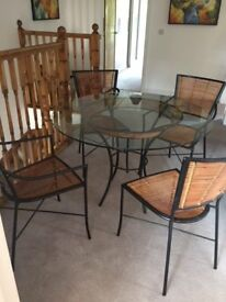 Glass topped dining table suitable for conservatory, with 4 matching chairs. John Lewis