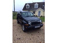 Jeep Cherokee 2.8L TD in Black with full leather upholstery. Heated front seats & towbar