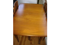 Light oak dining table first class condition with 4 upholstered chairs in A1 condition