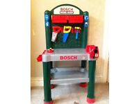 Child's toy work bench & tools