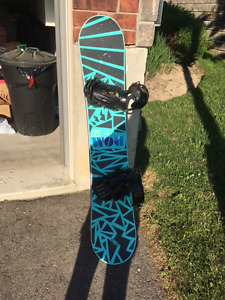 skis , poles, and snowboard and case
