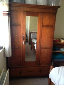 Lockable vintage wardrobe with mirror and drawer.