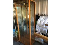 Glass display cabinet with shelves and light