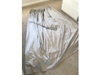 Two sets of Fully lined silver satin curtains with tassle tie backs in excellent condition.