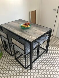 Compact table and 4 chairs
