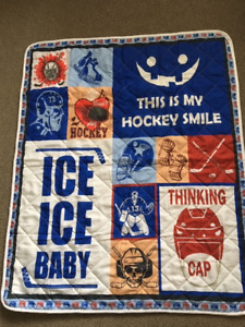 CRIB SIZE HOCKEY QUILT - BRAND NEW IN PACKAGE