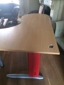 Large desk in great condition: 185cmx120cm at the widest.Cable tidy-holes, sturdy legs, no markings