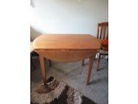 Circular drop leaf dining room table
