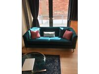 BEAUTIFUL TEAL VELVET SOFA - CURRENT GREENWICH RANGE AT LEE LONGLANDS. AS NEW.