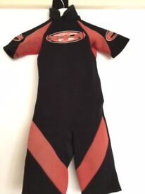 Small 'Sola' shortie wetsuit - age about 6-8? Red and black.