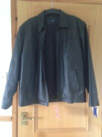 Leather jacket size XL - never bring worn - still with tags - zipped front Price reduced