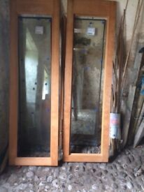 Pair of doors with glazed panels. 580mm wide 1980mm high complete with glass panels and trims