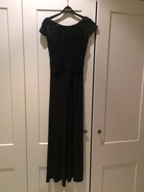 Evening dress with jewelled sleeves