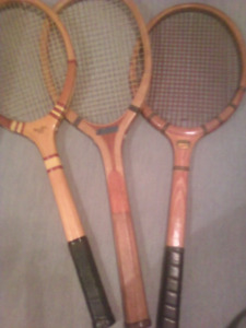 Three vintage wooden tennis racquets