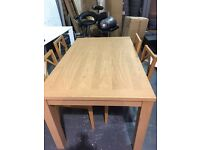 BRAND NEW OAK EFFECT DINING TABLE WITH 4 CHAIRS
