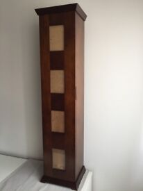 Decorative picture frames with storage. Dark solid wood unit