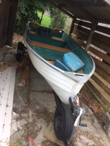 12 ft Aluminum boat and small 6.0 Mercury Motor on trailer