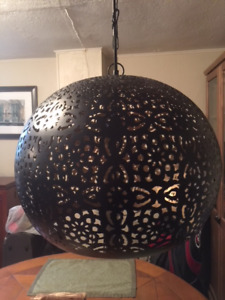 Hanging black globe single pendant light with unique pattern