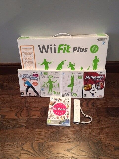 Nintendo Wii, Balance Board and Nunchuks with games
