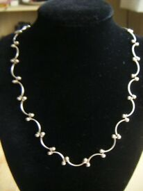 Four Silver Chain Necklaces