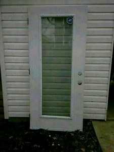 Steelwood Door and a Roll of Tyvek House Wrap